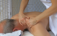 Physiotherapist applying massage for Back and Neck Pain treatment